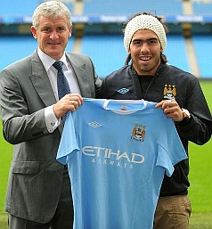 Mark Hughes and Carlos Tevez with the new shirt