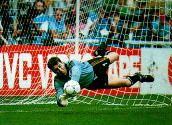 Packie Bonner making a saving during a penalty shoot out at the 1990 World Cup